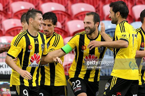 Wellington Pheonix team mates celebrate a goal during the round 10 ALeague match between the Newcastle Jets and the Wellington Phoenix at Hunter...