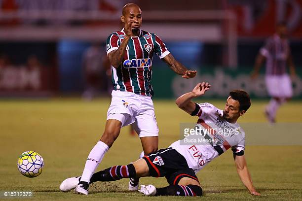 Wellington Silva of Fluminense struggles for the ball with Rodrigo Caio of Sao Paulo during a match between Fluminense and Sao Paulo as part of...