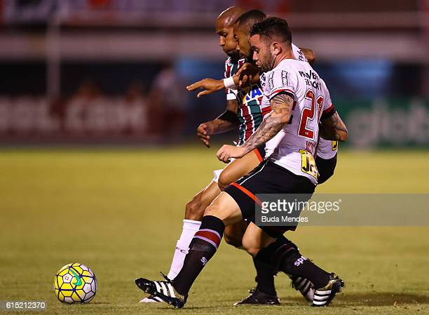 Wellington Silva of Fluminense struggles for the ball with Wesley Mena of Sao Paulo during a match between Fluminense and Sao Paulo as part of...