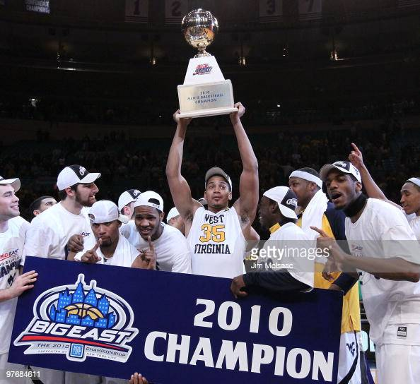 Wellington Smith of the West Virginia Mountaineers celebrates with the trophy after defeating the Georgetown Hoyas to win the championship of the...