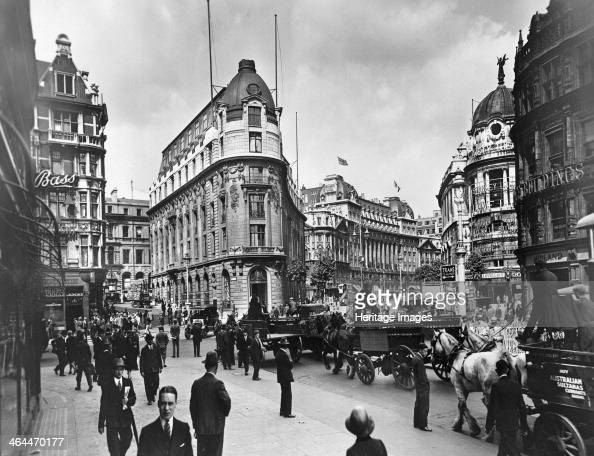 Wellington Street and Aldwych London Wellington Street straight ahead on the left and Aldwych curving round to the right Horse drawn carts pass along...