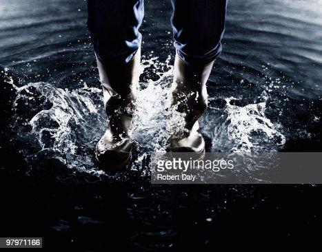 Wellingtons splashing in water : Stock Photo