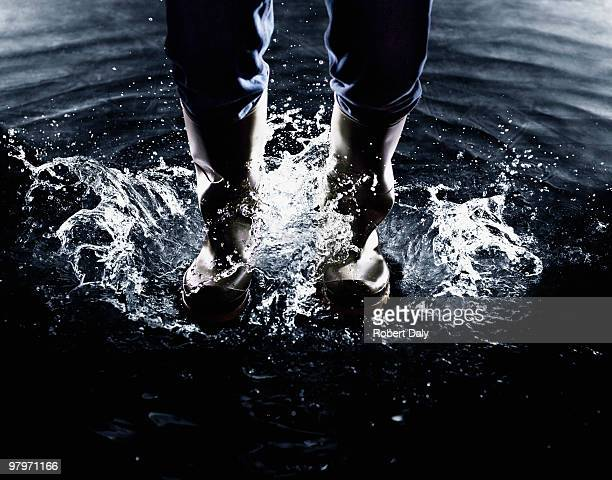 Wellingtons splashing in water