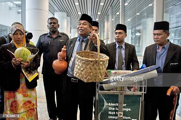 A wellknown Malaysian malay bomoh Ibrahim Mat Zin offering to locate the missing Malaysia Airlines flight 370 plane using a spiritual method and...