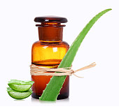 Old chemist`s bottles with aloe vera for medicine and wellness.