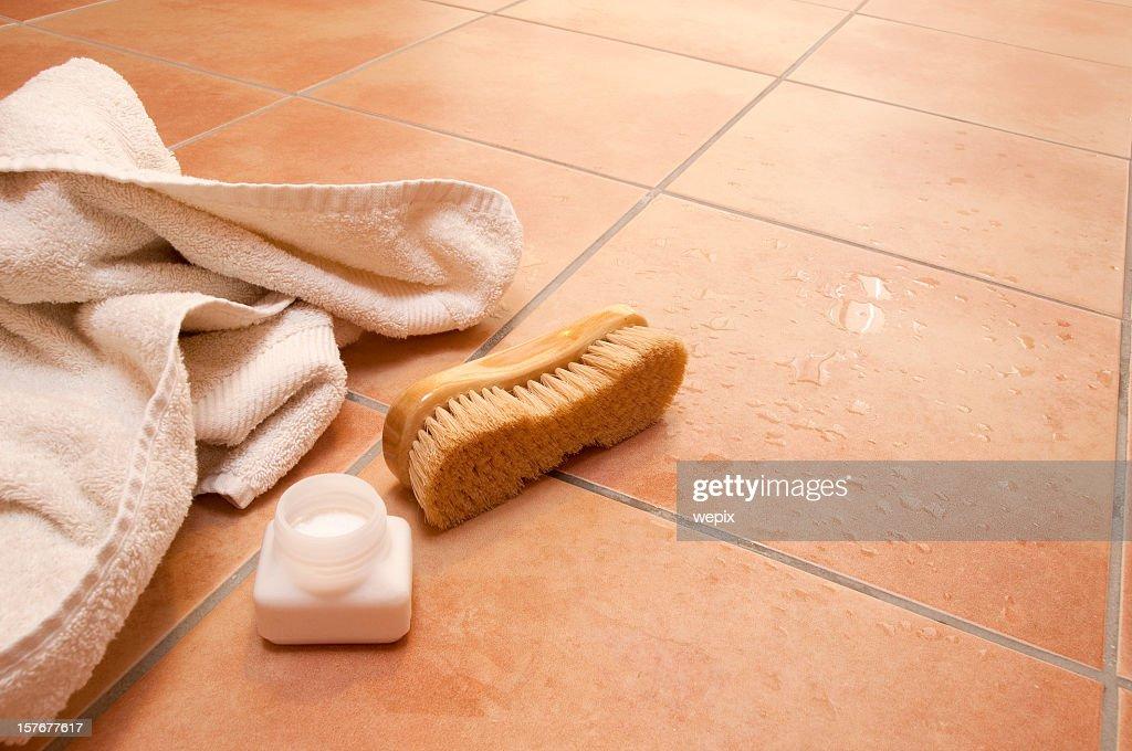 wellness towel brush bath salts wet terracotta tile floor stock photo