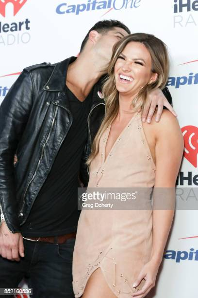 Wells Adams and Becca Tilley arrive at the 2017 iHeartRadio Music Festival at TMobile Arena on September 22 2017 in Las Vegas Nevada