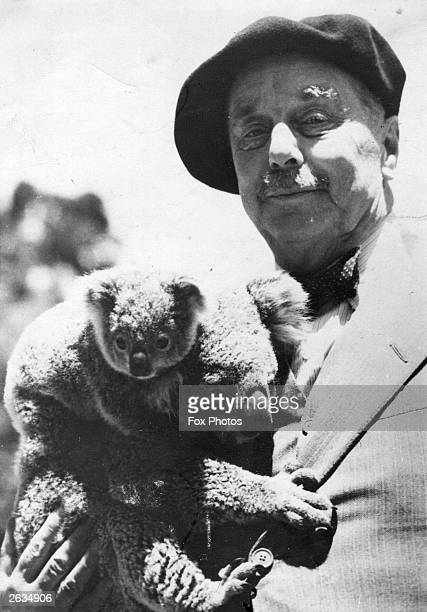 H G Wells English novelist and short story writer with a koala bear and her baby
