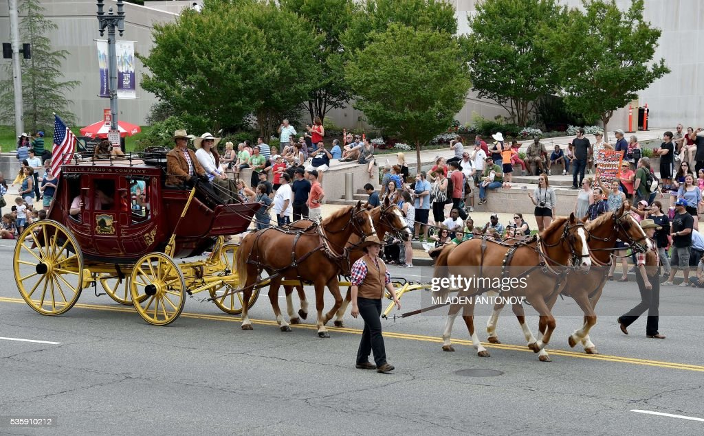 A Wells Fargo Bank stagecoach takes part in the Memorial Day Parade on Constitution Avenue in Washington DC on May 30, 2016. / AFP / MLADEN