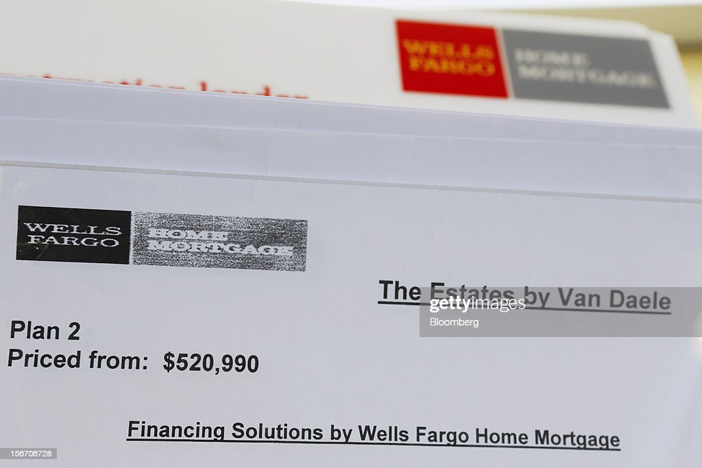 Wells Fargo & Co. home mortgage financing information is displayed inside of a model home at the Van Daele Estates at Etiwanda development in Rancho Cucamonga, California, U.S., on Sunday, Nov. 18, 2012. The U.S. Census Bureau is scheduled to release housing starts figures on Nov. 20. Photographer: Patrick T. Fallon/Bloomberg via Getty Images