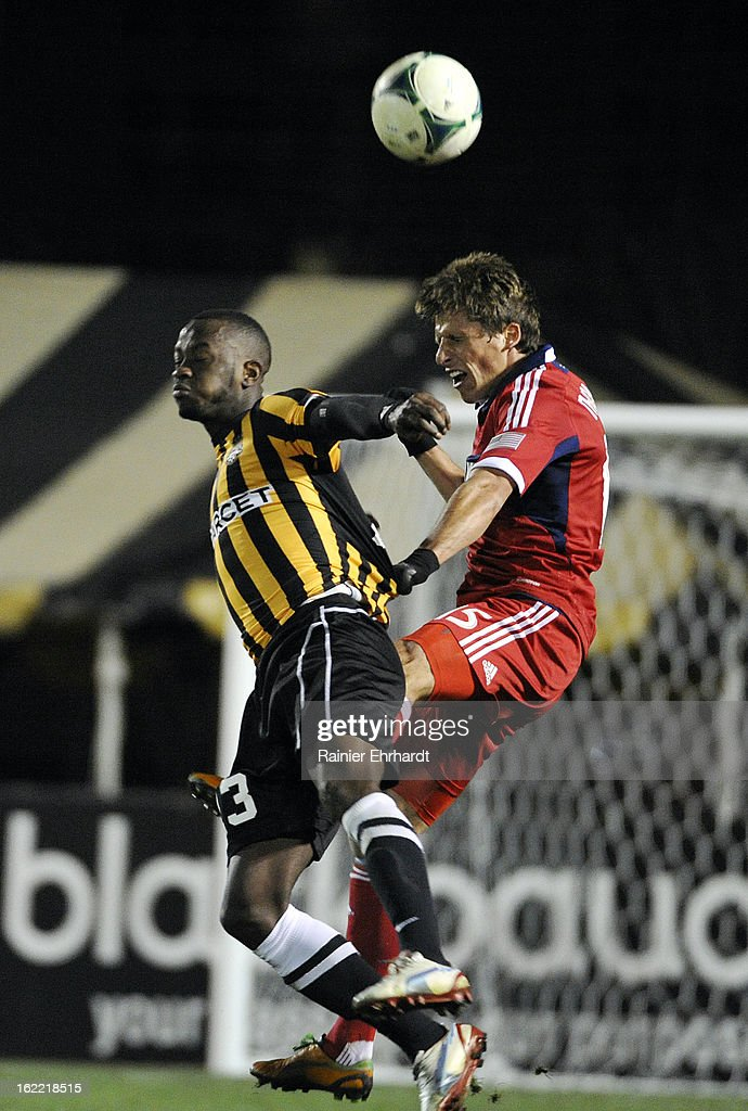 Wells Thompson #15 of the Chicago Fire and Ebrima Jatta #3 of the Charleston Battery jump for a header during the second half of a game at Blackbaud Stadium on February 20, 2013 in Charleston, North Carolina.