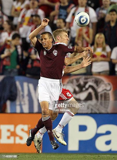 Wells Thompson of the Colorado Rapids heads the ball against Tim Ream of the New York Red Bulls at Red Bull Arena on May 25 2011 in Harrison New...
