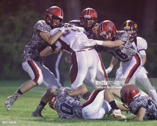 Wells vs Cape Elizabeth football A host of Wells defenders work to bring down Jack Glanville of Cape Elizabeth on a run in the first half