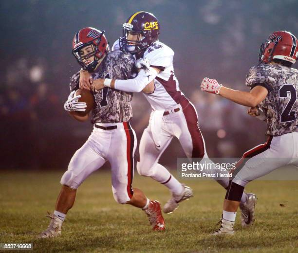 Wells vs Cape Elizabeth football Jack Talevi of Wells is brought down for a loss by Jacob Budischewsky of Cape Elizabeth in the first half