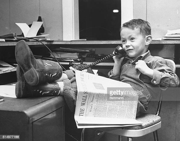 Big Businessman With his cowboy boots planted firmly in the world of high finance fiveyearold Richard B 'Rickey' Wright of Wellston Ohio keeps busy...