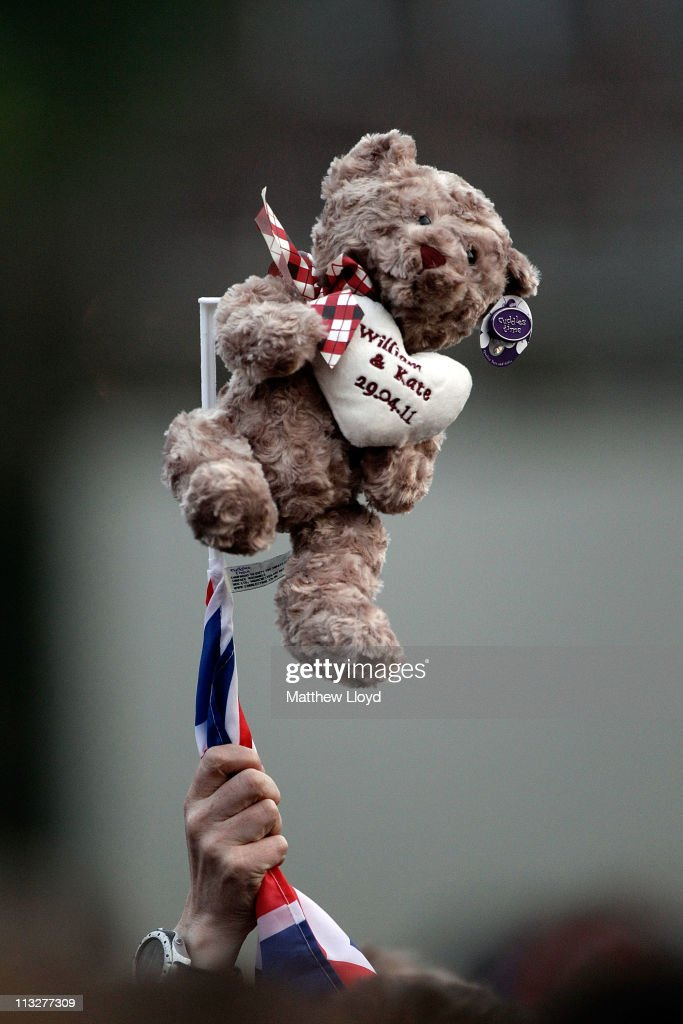 A wellwisher holds aloft a teddy bar in front of Buckingham palace before the Royal family return from Clarence House on April 29, 2011 in London. The marriage of Prince William, the second in line to the British throne, to Catherine Middleton is being held in London today. The Archbishop of Canterbury conducted the service which was attended by 1900 guests, including foreign Royal family members and heads of state. Thousands of well-wishers from around the world have also flocked to London to witness the spectacle and pageantry of the Royal Wedding and street parties are being held throughout the UK.