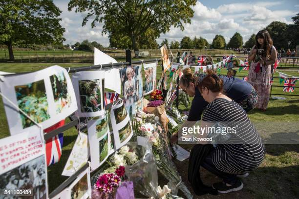 Wellwishers and Royal 'enthusiasts' gather outside the gates of Kensington Palace where tributes continue to be left on the 20th anniversary of the...