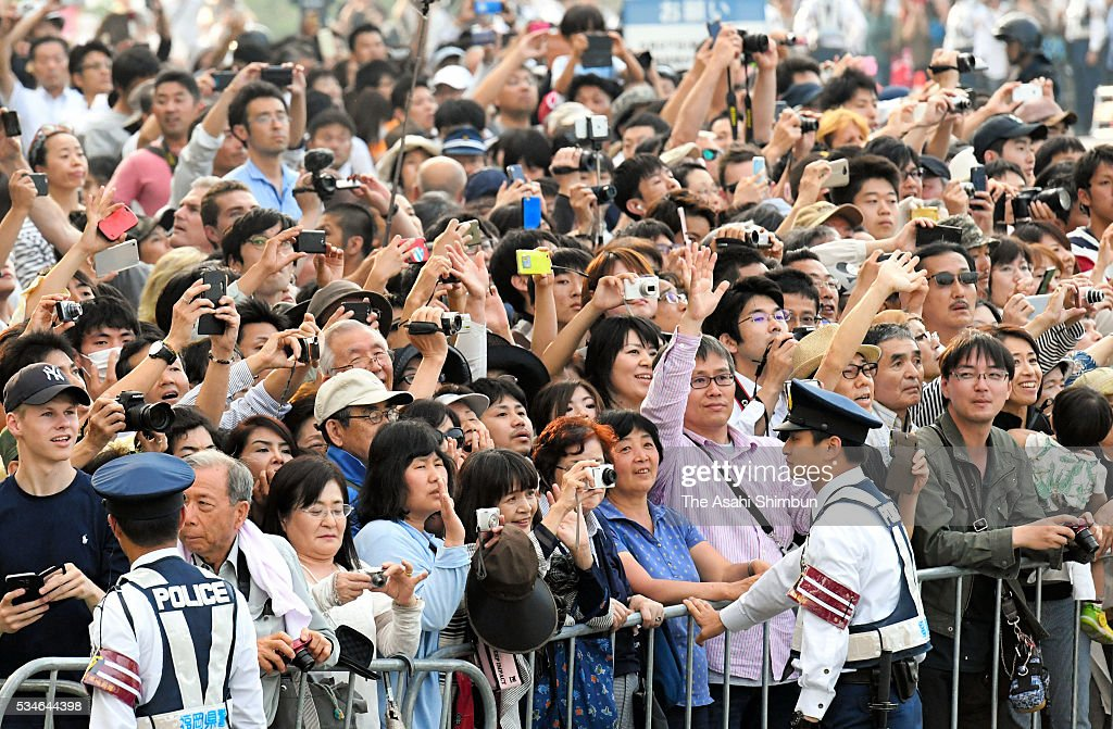 Well-wishers wait for the arrival of the U.S. President <a gi-track='captionPersonalityLinkClicked' href=/galleries/search?phrase=Barack+Obama&family=editorial&specificpeople=203260 ng-click='$event.stopPropagation()'>Barack Obama</a> at the Hiroshima Peace Memorial Park on May 27, 2016 in Hiroshima, Japan. Obama becomes the first sitting U.S. president to visit Hiroshima, where the first atomic bomb was dropped in 1945 at the end of World War II.