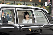 Wellwishers wave to bride Princess Sayako prior to her wedding ceremony at the Imperial Hotel on November 15 2005 in Tokyo Japan