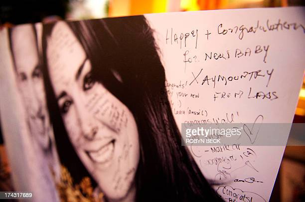 A wellwishing message to Britain's Prince William and Kate Duchess of Cambridge from a visitor from Laos is seen on a giant card congratulating the...