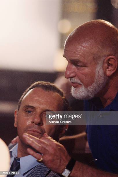 Welsh actor Anthony Hopkins and British director screenwriter actor and producer John Schlesinger on the set of Schlesinger's film The Innocent