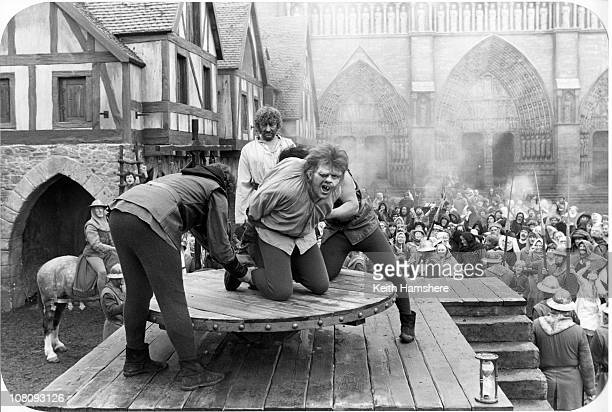 Welsh actor Anthony Hopkins as Quasimodo in the film 'The Hunchback of Notre Dame' aka 'Hunchback' 1982 Here he is tied down for a public flogging