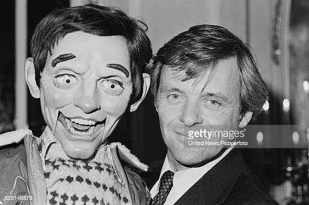 Welsh actor Anthony Hopkins pictured with the ventriloquist dummy named Fats from the film Magic in London on 22nd January 1979