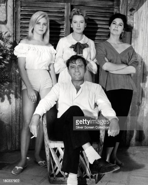 Welsh actor Richard Burton with actresses Sue Lyon Deborah Kerr and Ava Gardner in a promotional portrait for 'The Night of the Iguana' directed by...