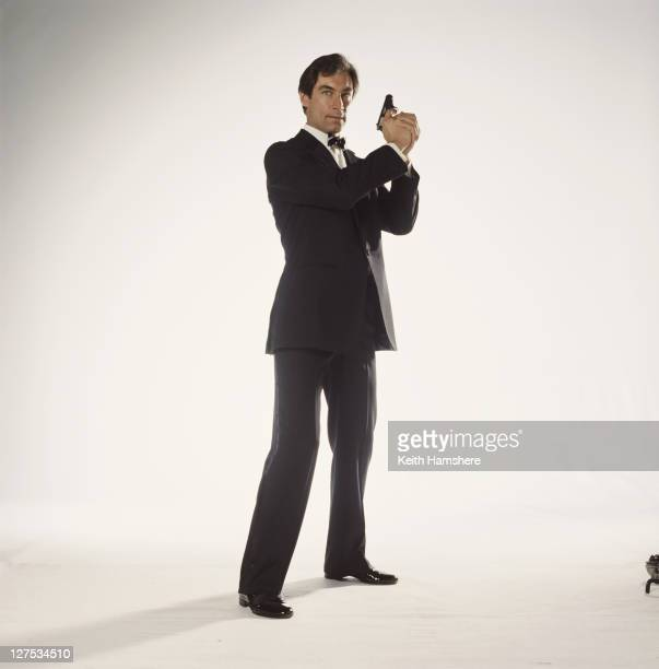 Welsh actor Timothy Dalton poses as 007 in a publicity still for the 1987 James Bond film 'The Living Daylights' 1986 He is holding his trademark...