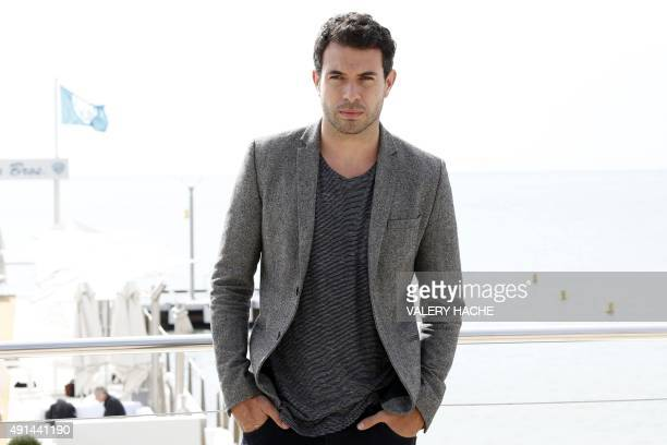 Welsh actor Tom Cullen poses for the photocall of the TV series 'The Five' at the MIPCOM audiovisual trade fair in Cannes southeastern France on...