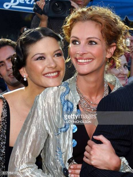 Welsh actress Catherine ZetaJones hugs US actress Julia Roberts at the premiere of their new film 'America's Sweethearts' 17 July 2001 in Los Angeles...