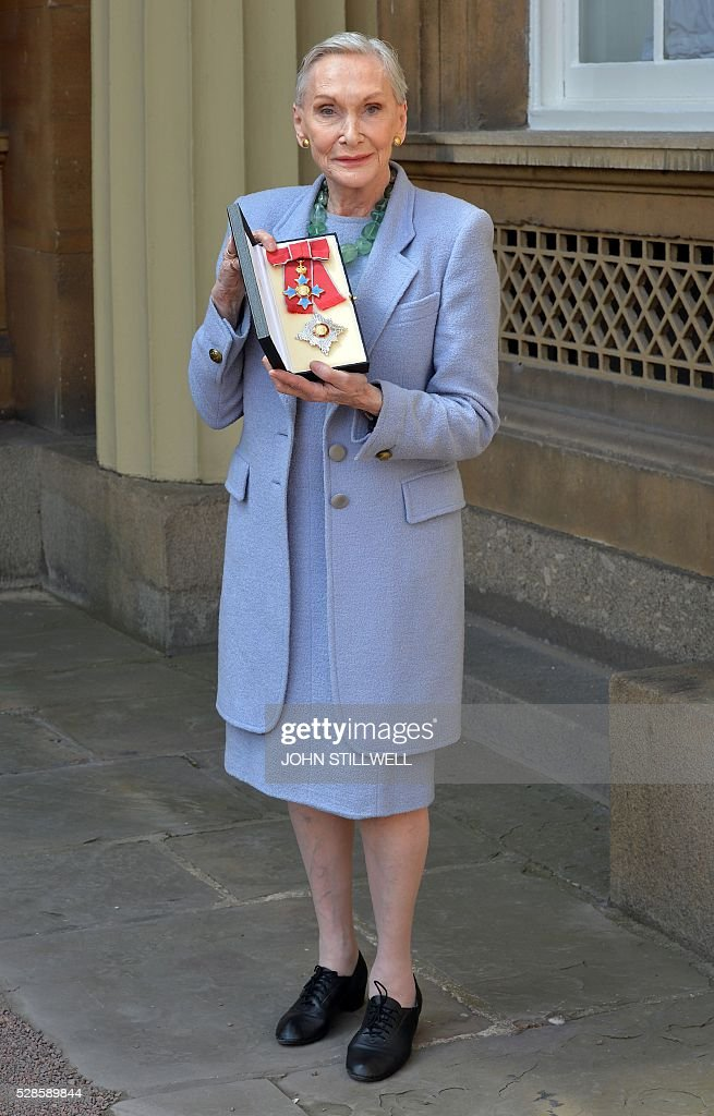 Welsh actress Sian Phillips poses with her insignia after being appointed a Dame Commander of the order of the British Empire (DBE) at an investiture ceremony at Buckingham Palace in London in London on May 6, 2016. / AFP / POOL / John Stillwell