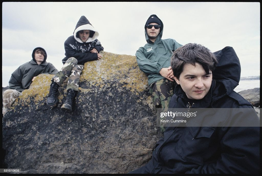 Welsh alternative rock group the Manic Street Preachers, on the beach at Swansea, south Wales, 19th August 1994. Left to right: bassist Nicky Wire, guitarist Richey James Edwards, singer James Dean Bradfield and drummer Sean Moore.