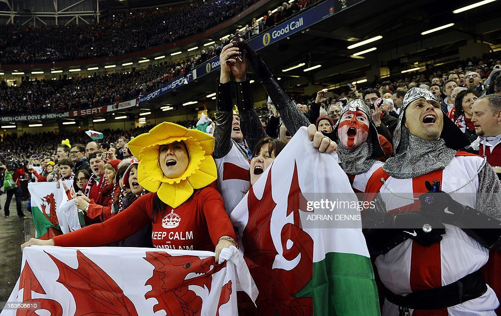 Welsh and English fans in fancy dress wait for the start of the Six Nations international rugby union match between Wales and England at The Millennium Stadium in Cardiff, Wales on March 16, 2013. Wales won 30-3. AFP PHOTO / ADRIAN DENNIS NOT FOR MARKETING OR ADVERTISING USE / RESTRICTED TO EDITORIAL USE.