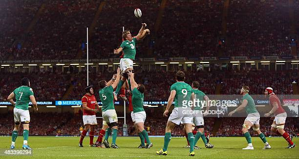 Welsh and Irish players vie for the ball in the line out during the 2015 Rugby World Cup warm up rugby union match between Wales and Ireland at The...