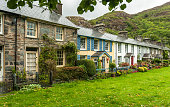 Cottages in the village of Beddgelert, Snowdonia with hills in the background.