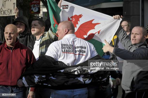 A Welsh Defence League protester displays his English Defence League Birmingham Division Tshirt during a protest in Swansea Wales