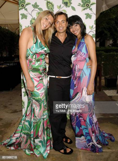 Welsh designer Julien Macdonald with models Minna Axdord and Rupal Parmar at a launch party for his new range of wallpaper for Graham Brown at the...