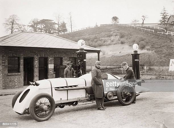 Welsh engineer and racing driver J G ParryThomas waits while his car 'Babs' is filled with petrol at Brooklands motor racing circuit in Surrey 23rd...