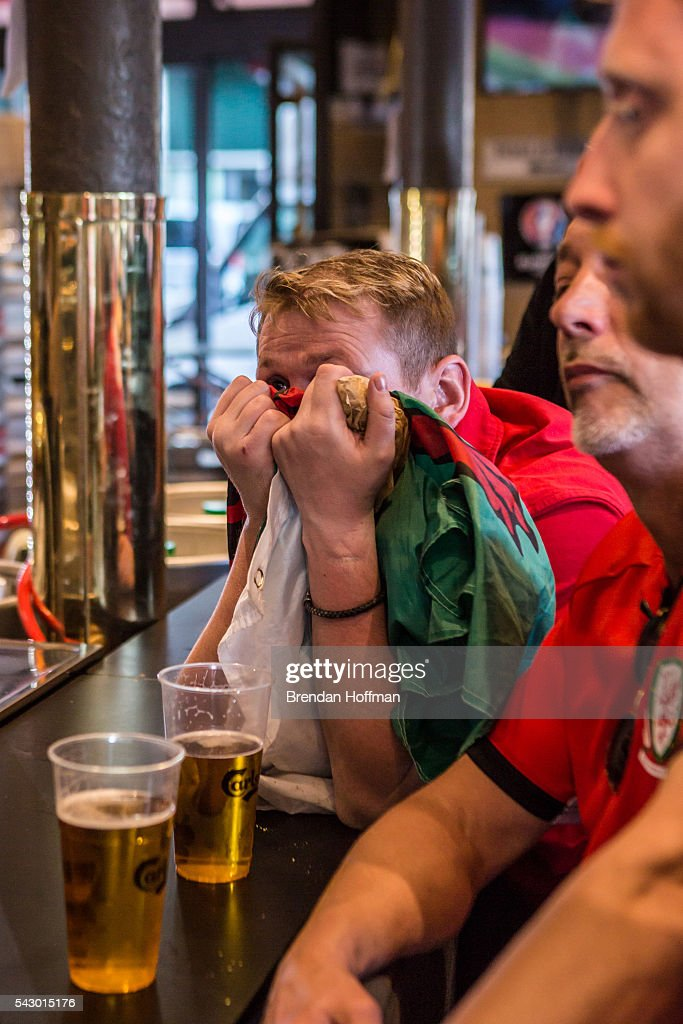 A Welsh fan at a bar near the Parc des Princes stadium waits for the final seconds of the game to expire while watching a live television broadcast of the football match between Wales and Northern Ireland during UEFA Euro 2016 tournament on June 25, 2016 in Paris, France. The two teams met in the Round of 16 at Parc des Princes in Paris, where Wales won 1-0.