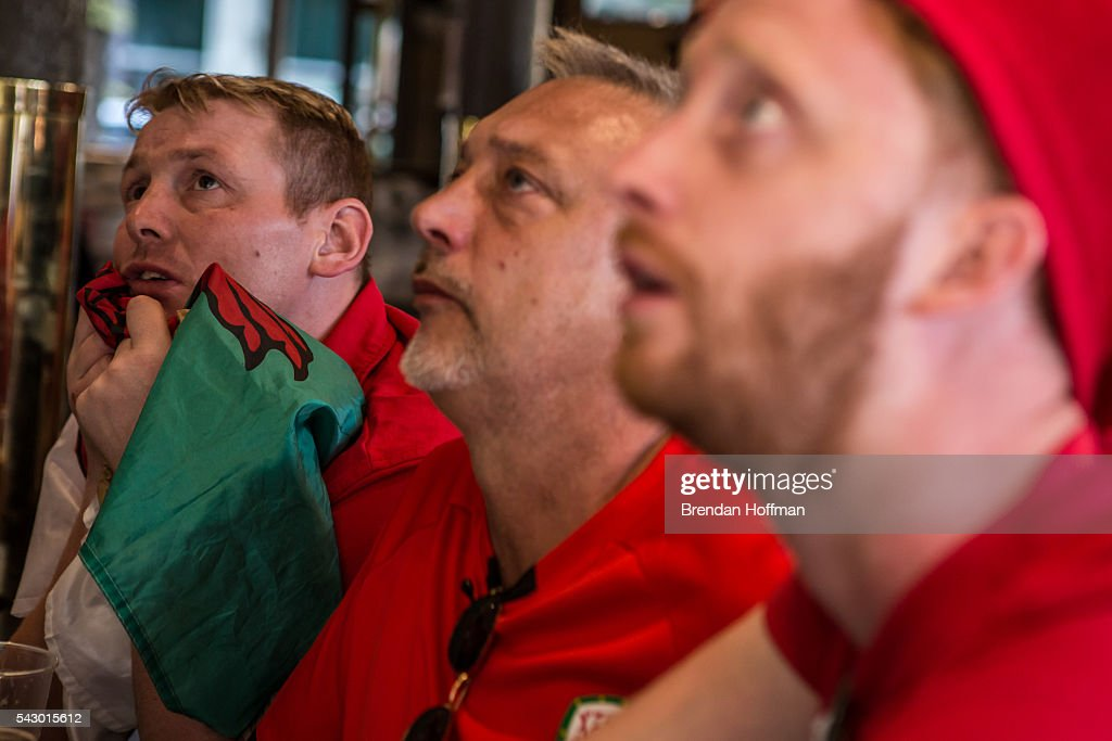 Welsh fans at a bar near the Parc des Princes stadium watch a live television broadcast of the football match between Wales and Northern Ireland during UEFA Euro 2016 tournament on June 25, 2016 in Paris, France. The two teams met in the Round of 16 at Parc des Princes in Paris, where Wales won 1-0.