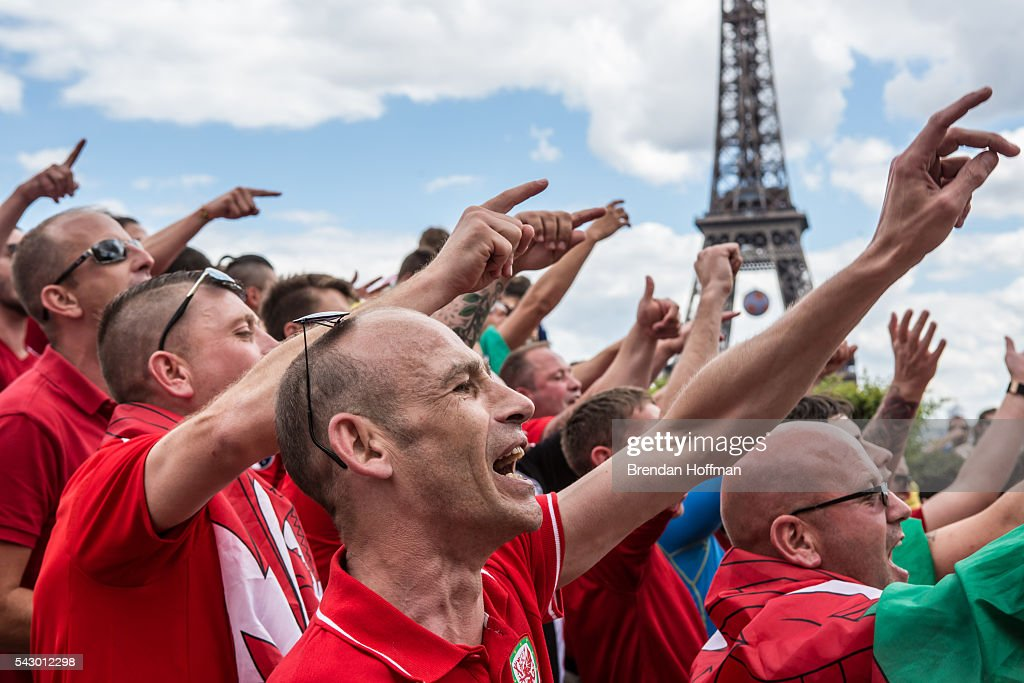 Welsh fans celebrate near the Eiffel Tower before the football match between Wales and Northern Ireland during UEFA Euro 2016 tournament on June 25, 2016 in Paris, France. Wales edged Northern Ireland in the Round of 16 at Parc des Princes in Paris.
