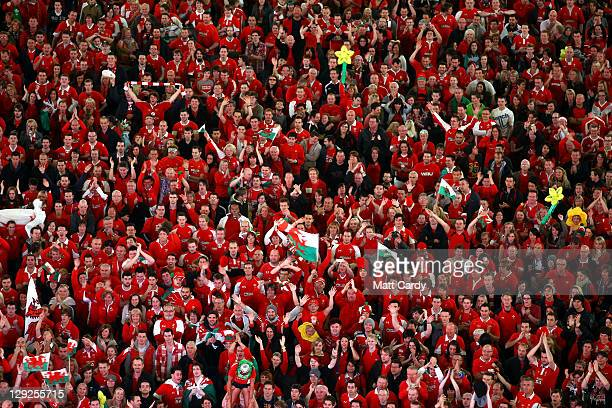 Welsh fans react as they watch Wales v France on a giant screen at the Millennium Stadium on October 15 2011 in Cardiff Wales Organisers say around...
