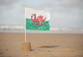 Welsh Flag flying in a sandcastle on a beautiful Cymru beach