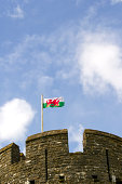 The Red Dragon, the flag of Wales, UK, flying above battlements