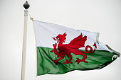 The Welsh flag against a cloudy sky