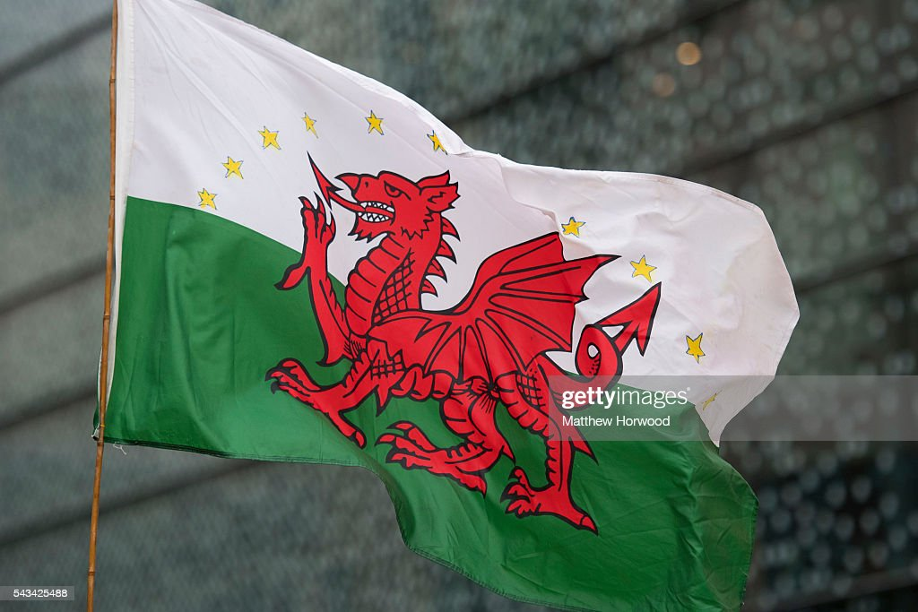 A Welsh flag with EU stars is seen during an anti-Brexit rally on June 28, 2016 on the Hayes in Cardiff, Wales. The protest is at a time of economic and political uncertainty following the referendum result last week, which saw the UK vote to leave the European Union.