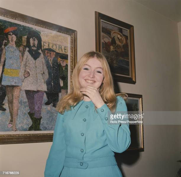 Welsh folk singer Mary Hopkin who has a hit single with the song 'Those Were The Days' pictured standing next to an oil painting in 1968