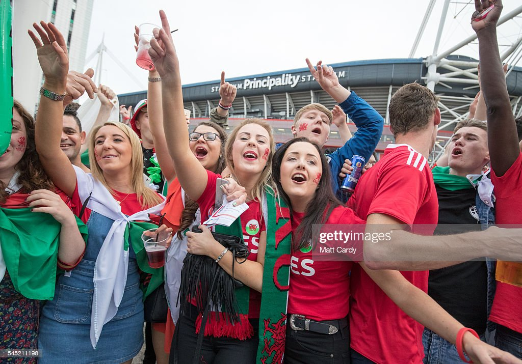 Welsh football fans cheer as they gather outside the Principality Stadium which is showing the Wales v Portugal game on a giant screen on July 6, 2016 in Cardiff, Wales. Wales plays Portugal in the Euro 2016 semi-final tonight in Lyon, France.