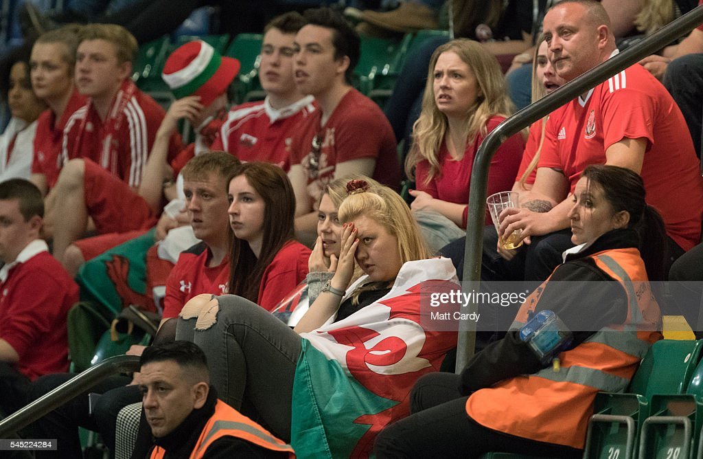 Welsh football fans react as the game draws to a close inside the Principality Stadium which is showing the Wales v Portugal game on a giant screen on July 6, 2016 in Cardiff, Wales. Wales plays Portugal in the Euro 2016 semi-final tonight in Lyon, France